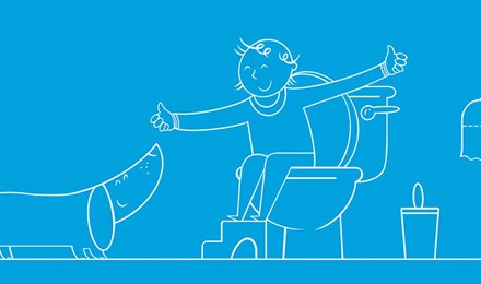 Ilustrirani dječak sjedi na zahodu s hoklicom te pokazuje psu palac gore