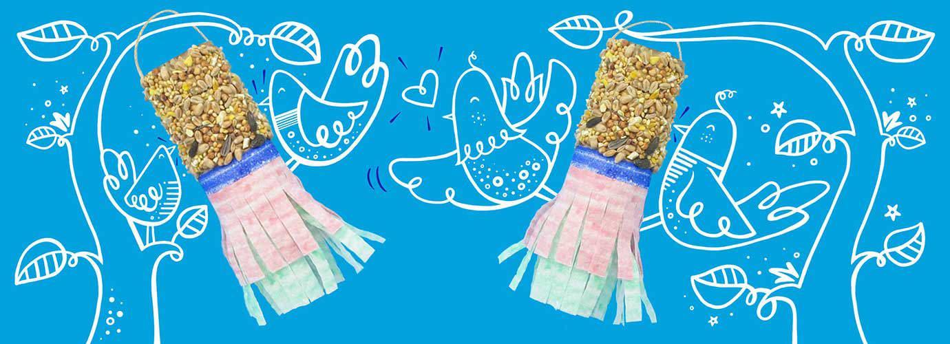 Ručno izrađene hranilice za ptice sa sjemenkama i ukrasnim papirnatim resama koje vise s ilustriranih grana s ilustriranim pticama