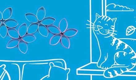 Blumen aus Pappe  vor einem illustrierten Wohnzimmer im Hintergrund
