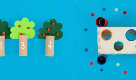 Spiele für die Entwicklung der Feinmotorik aus leeren Toilettenpapierrollen und Taschentuchboxen